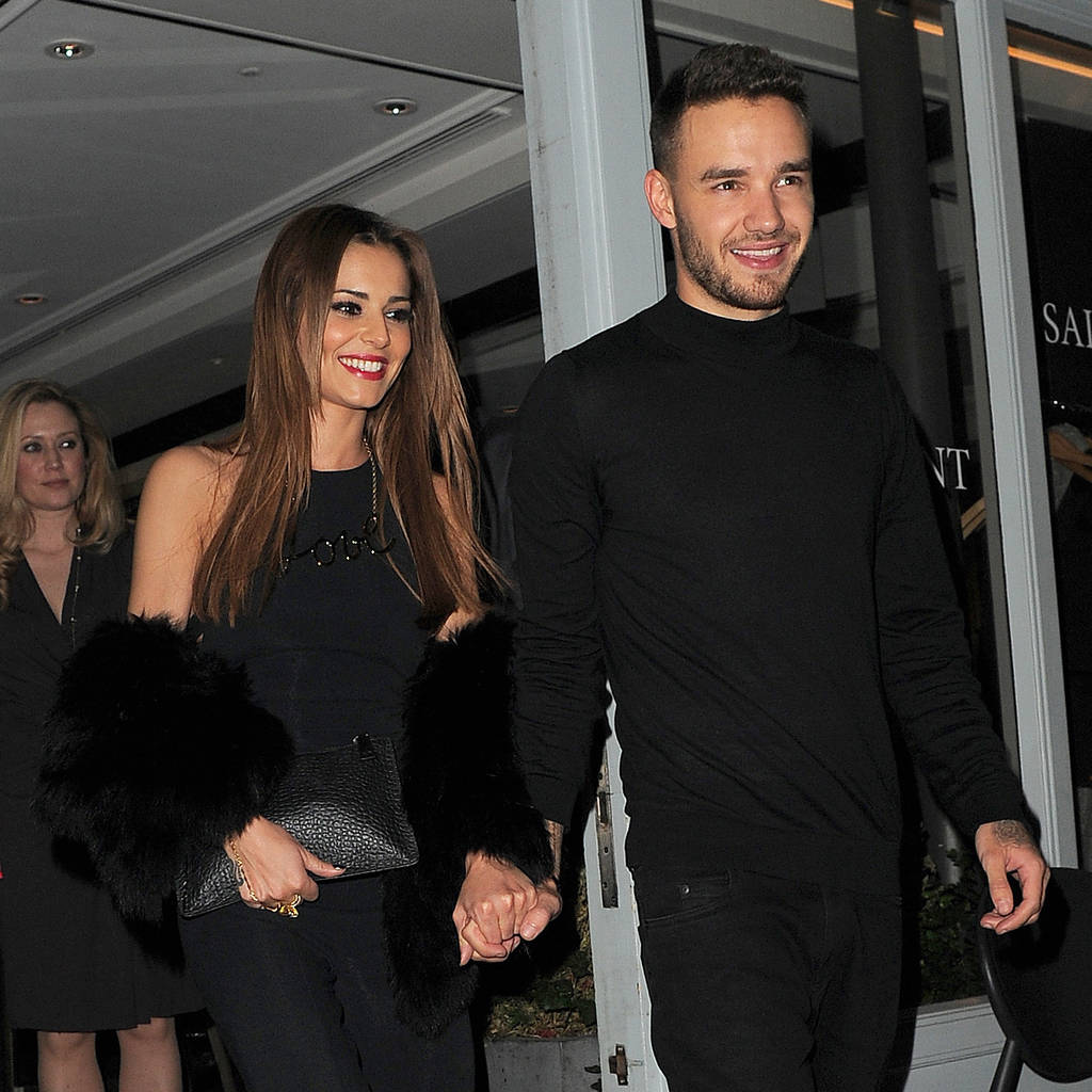 Liam Payne's girlfriend Cheryl embraces baby rumours by showing off growing belly