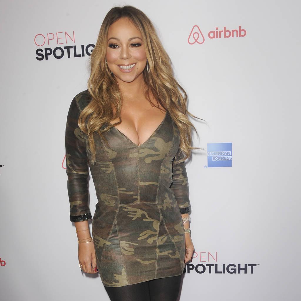 Mariah Carey goes public with back-up dancer toyboy beau