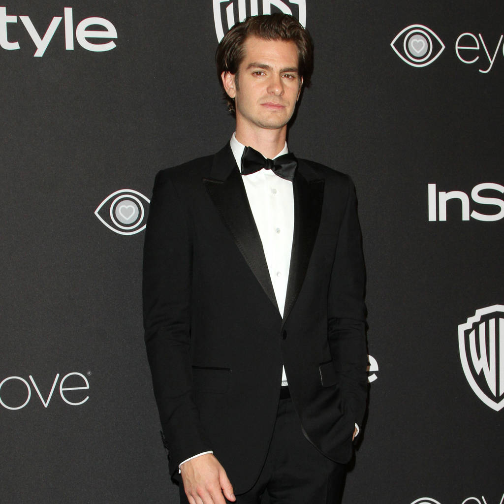 Andrew Garfield smooches presenter as he reveals motivation for Ryan Reynolds kiss