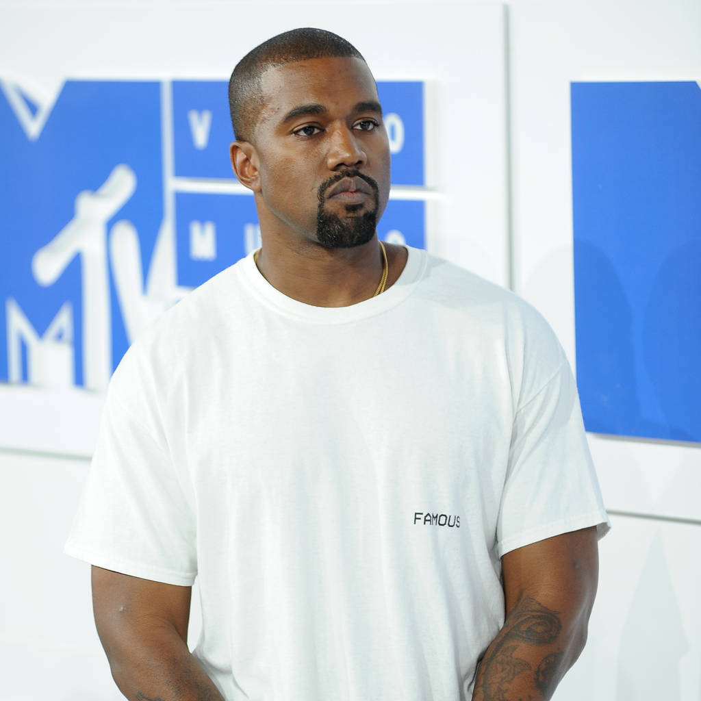 Kanye West 'pushed over edge' by anniversary of mum's funeral - report