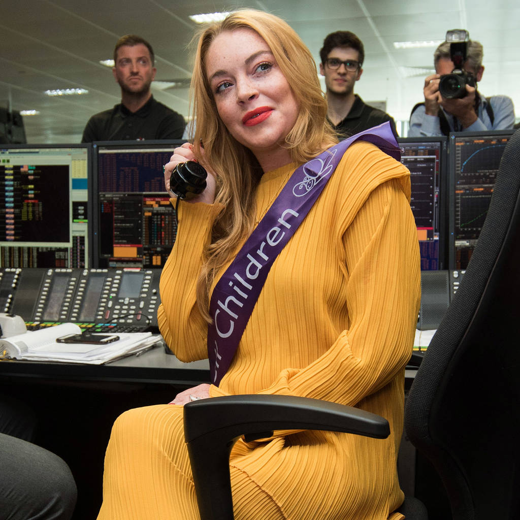 Lindsay Lohan makes red carpet comeback after seven-month hiatus